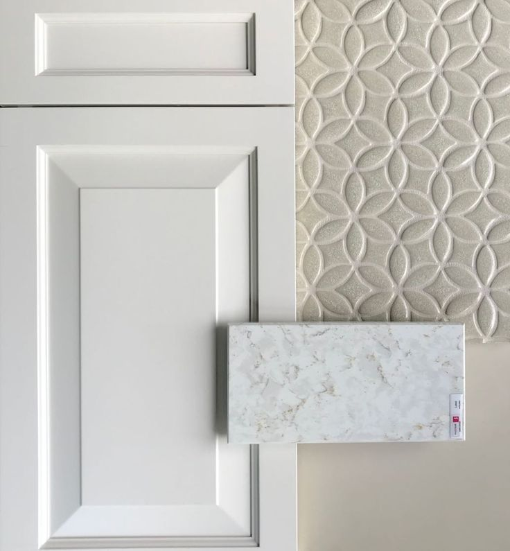 This classic Wedgewood white cabinet is paired with a polished lusso quartz with...