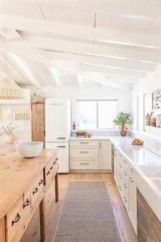 Kitchen with lower drawers instead of upper cabinets