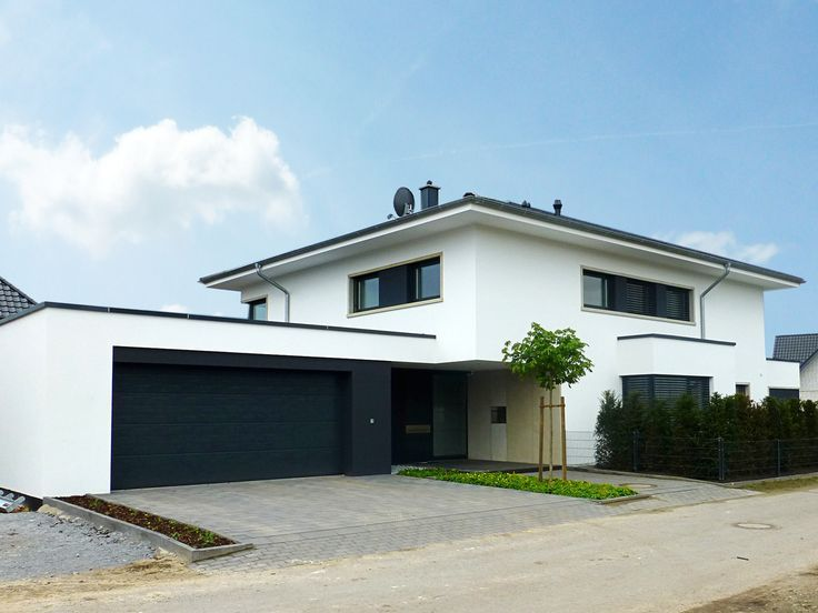 Detached house in Rietberg, city villa, Bauhaus style, tent roof, plaster facade, st ...