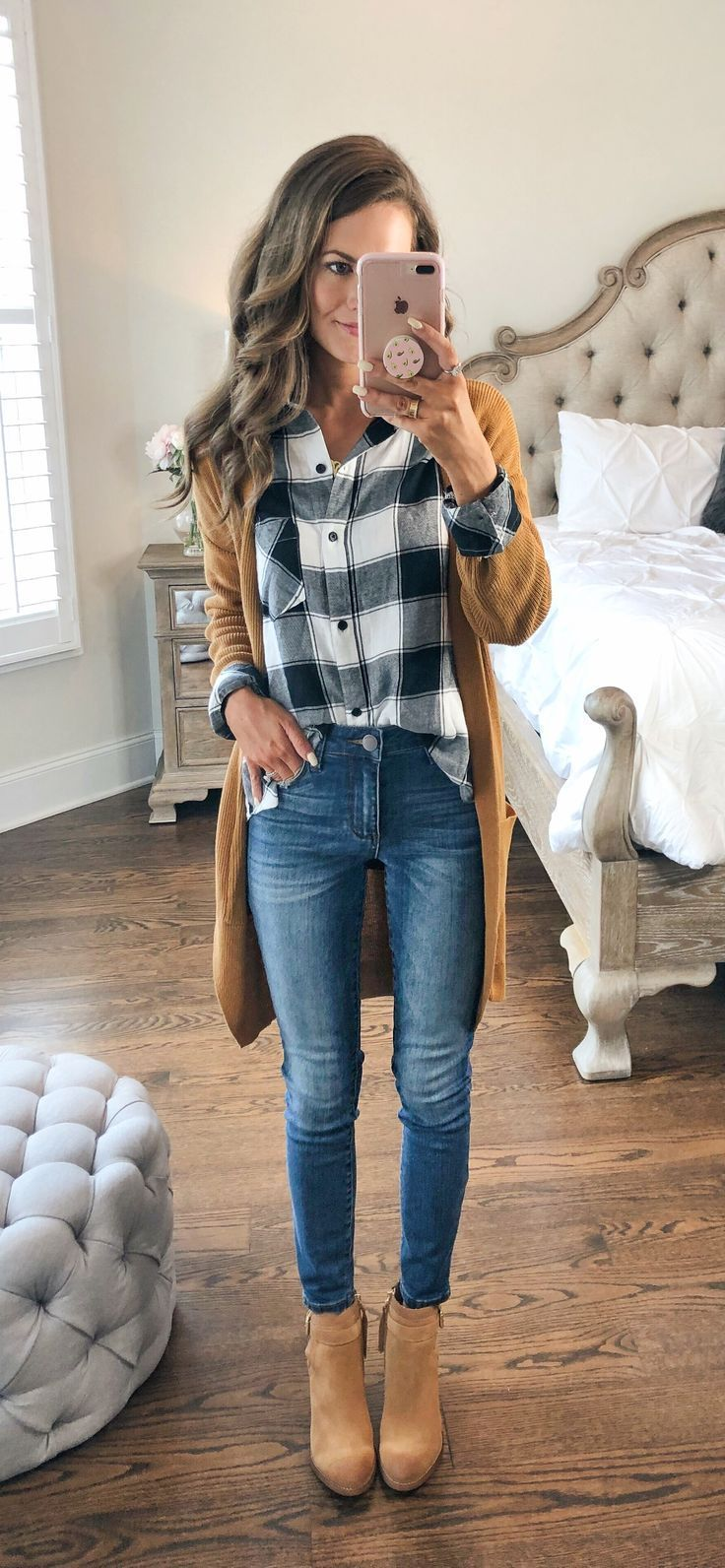 cozy autumn outfit made of checkered button-down with camel-colored long str ...
