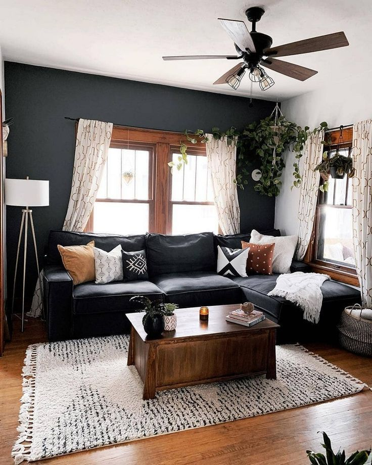 Living room design with a dark accent wall.