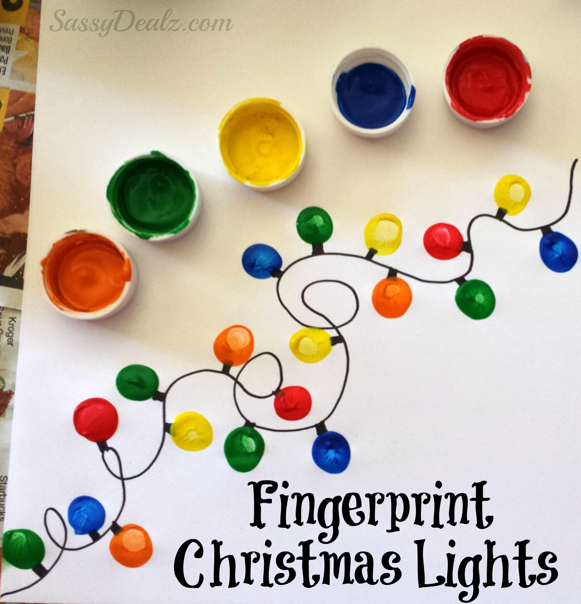 DIY Fingerprint Christmas Tree Light craft for kids! Just have the child dip the...
