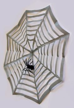 The fast Halloween decoration: spider web of paper. The basic principle of ...