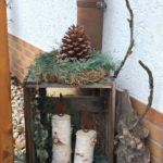 Christmas decoration at the house entrance with natural materials