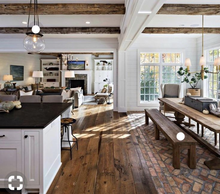Standing in the far corner of the kitchen with his back to the sliding door ... # ...