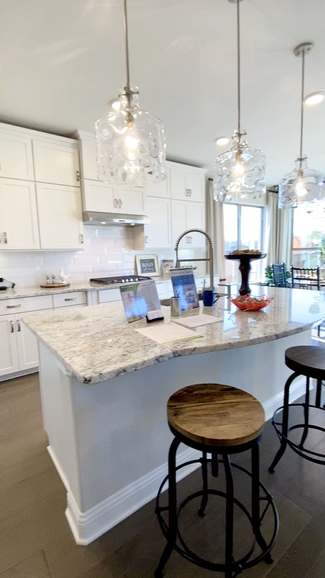 White kitchen cabinets and open concept floorplan
