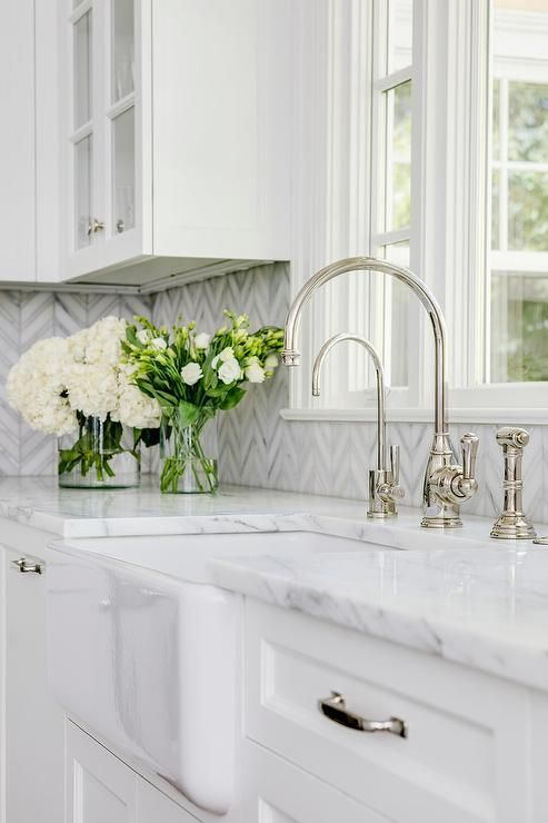 Farmhouse sink with white and gray marble counters - transition - kitchen